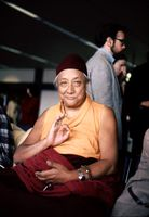 HH Dilgo Khyentse Rinpoche displaying the vitarka mudrā, 1976, SeaTac Airport, Seattle, Washington, USA.jpg